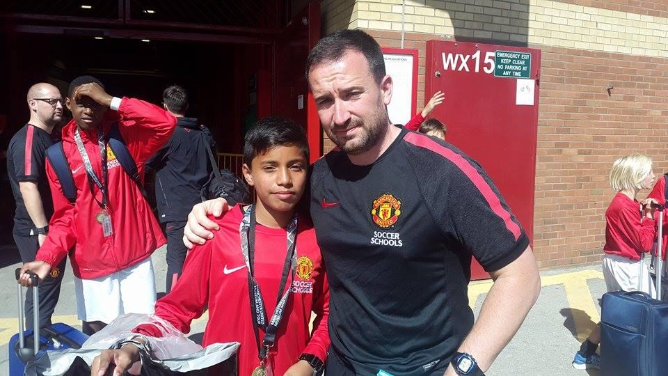 Daniel-David-Katuwal-with-the-coach.