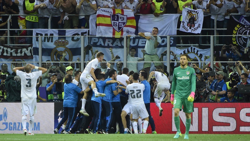 Real Madrid players celebrate with supporters after they won the UEFA Champions League final football match over Atletico Madrid at San Siro Stadium in Milan, on May 28, 2016. / AFP / OLIVIER MORIN (Photo credit should read OLIVIER MORIN/AFP/Getty Images)