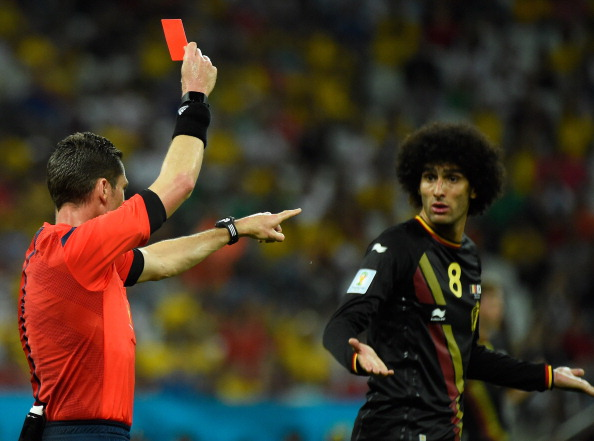 Australian referee Benjamin Jon Williams (L) gives a red card to Belgium's midfielder Steven Defour (not pictured) during a Group H football match between South Korea and Belgium at the Corinthians Arena in Sao Paulo during the 2014 FIFA World Cup on June 26, 2014. AFP PHOTO / ODD ANDERSEN (Photo credit should read ODD ANDERSEN/AFP/Getty Images)