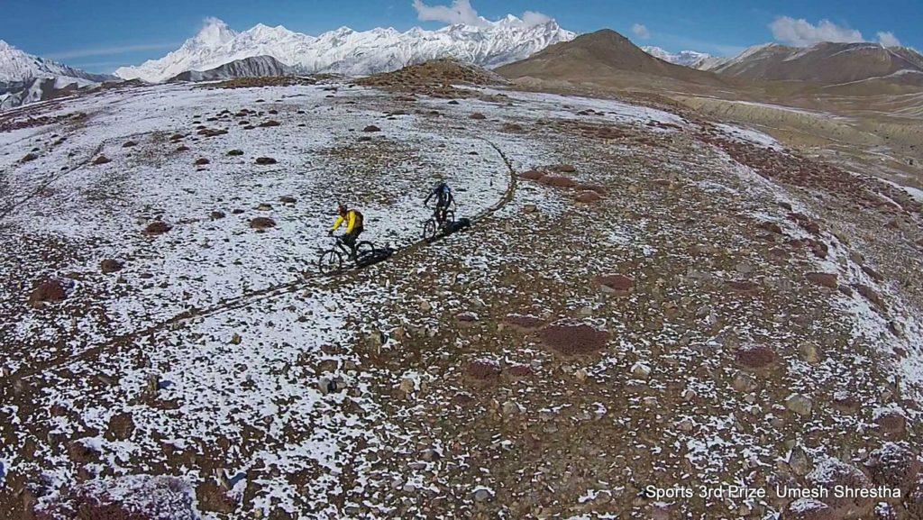 Bird's eye view of two mountain bikers in Muktinath, Mustang.