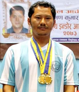 Jit Bahadur Moktan (centre) poses with three gold medals after the third Laxman Kumar Shrestha Memorial National Indoor Archery Tournament in Kathmandu on Friday, July 8, 2016. Photo: THT