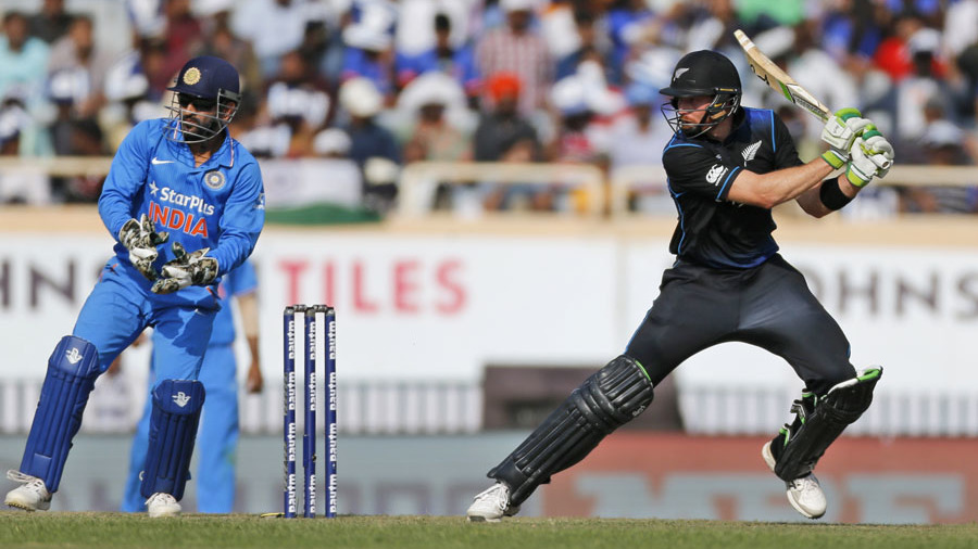 New Zealand's Martin Guptill, right, as Indian wicketkeeper and captain Mahendra Singh Dhoni watches during the forth one-day international cricket match between them in Ranchi, India, Wednesday, Oct. 26, 2016. (AP Photo/Rajanish Kakade)