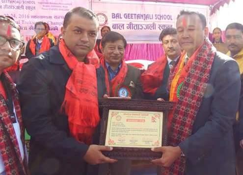 nrn-president-of-korea-raju-kshetri-receiving-certificate-from-healt-minister-gagan-thapa-2-1